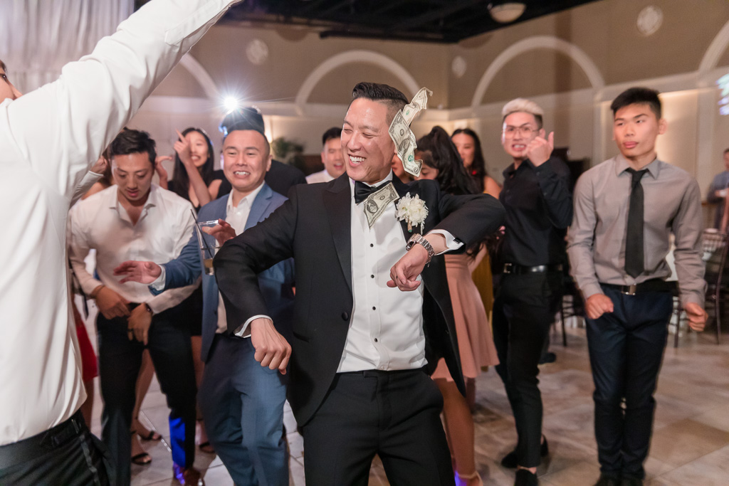groom dancing at the reception