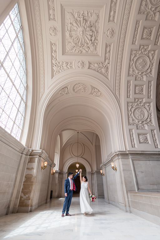 dancing under the big archway in SF city hall