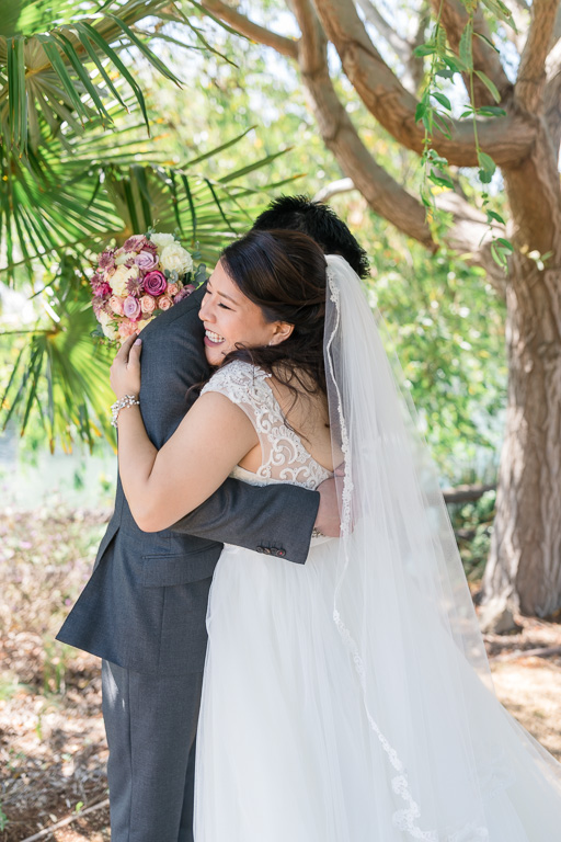 candid and happy wedding bride and groom portrait