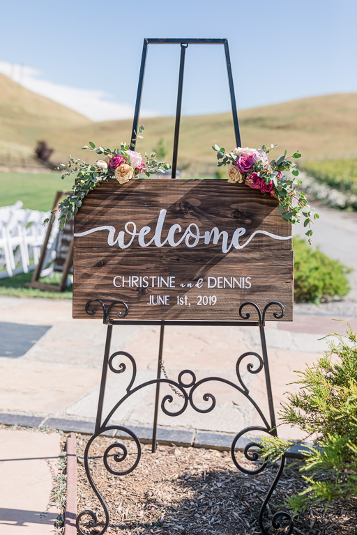wooden wedding welcome sign with floral