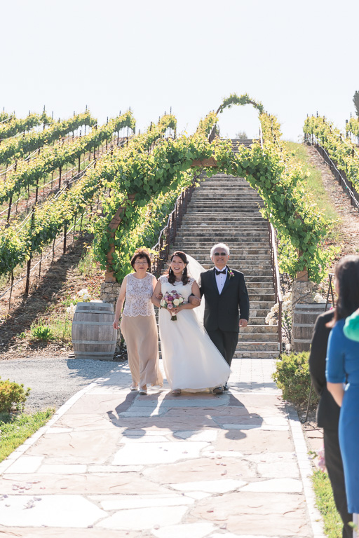 bride walked down that dramatic staircase through the vineyards to the ceremony