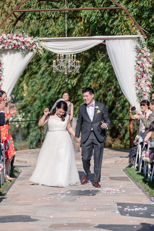 walking down the aisle as newlyweds