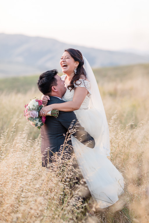 candid laughing photo of the bride and groom - Sunol wedding photographer