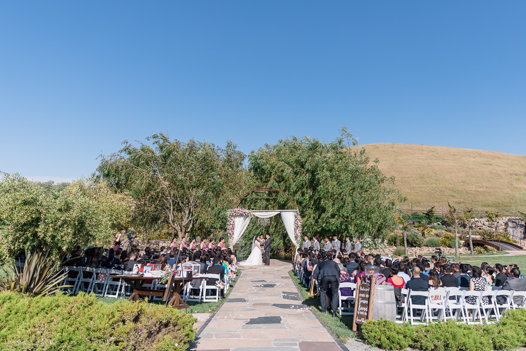 Sunol wedding ceremony surrounded by trees and mountains