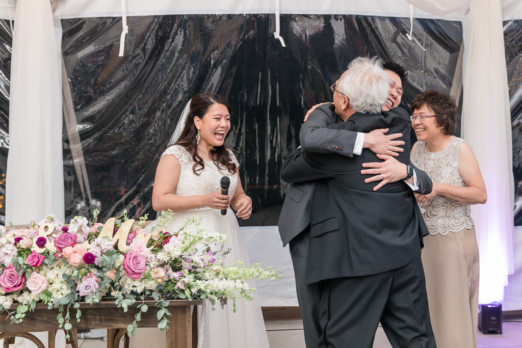 groom hugging father-in-law for his funny toast