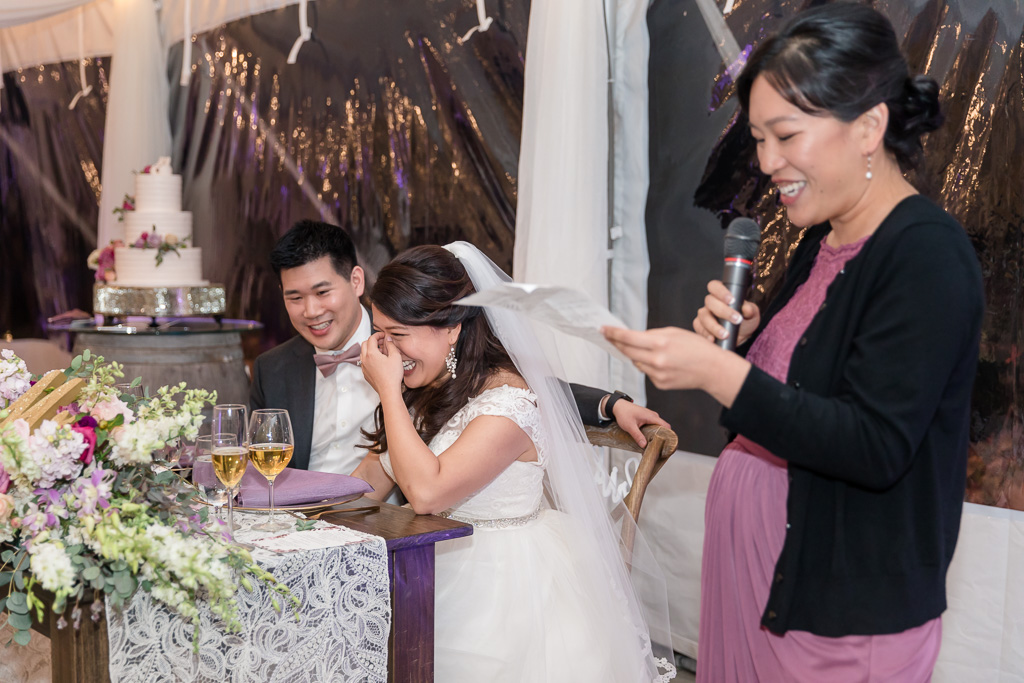 sister giving a hilarious speech to the newlyweds