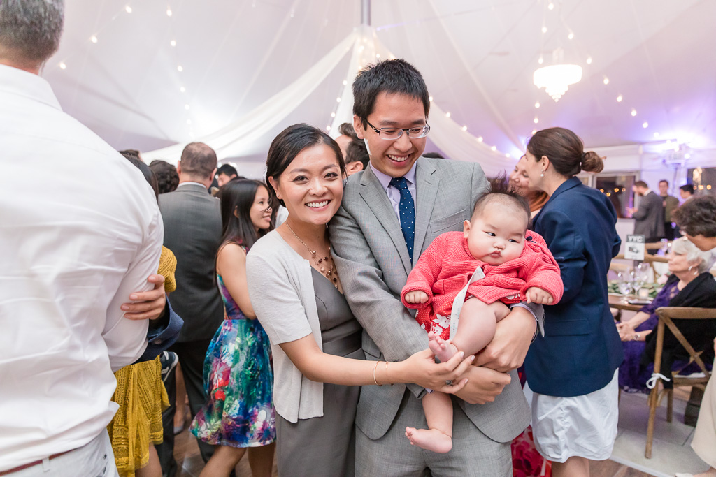 little wedding guest in parents' arms