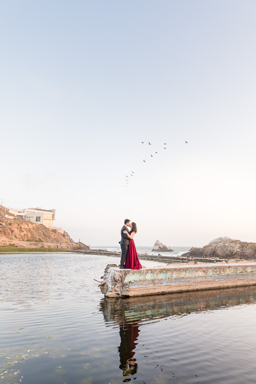 romantic San Francisco engagement photo kissing by the water