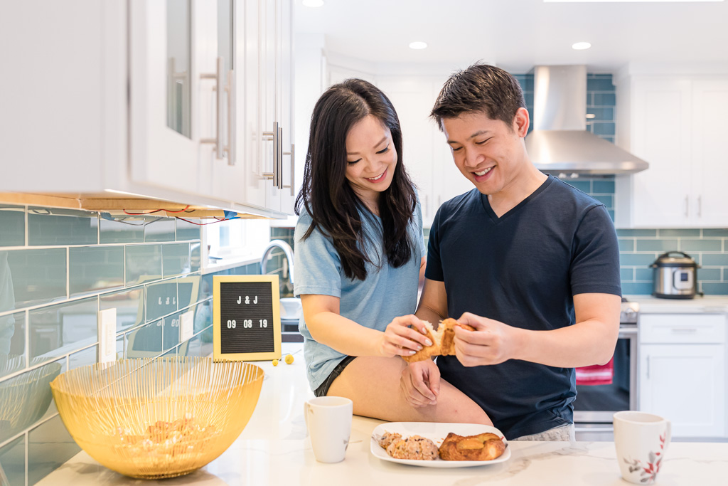 couple enjoying pastries together at home for their engagement session