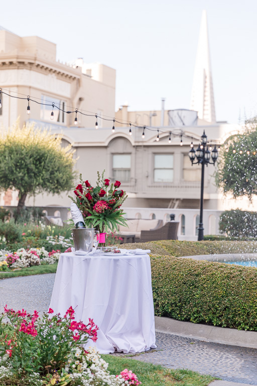 a private table setup for SF Fairmont rooftop surprise proposal