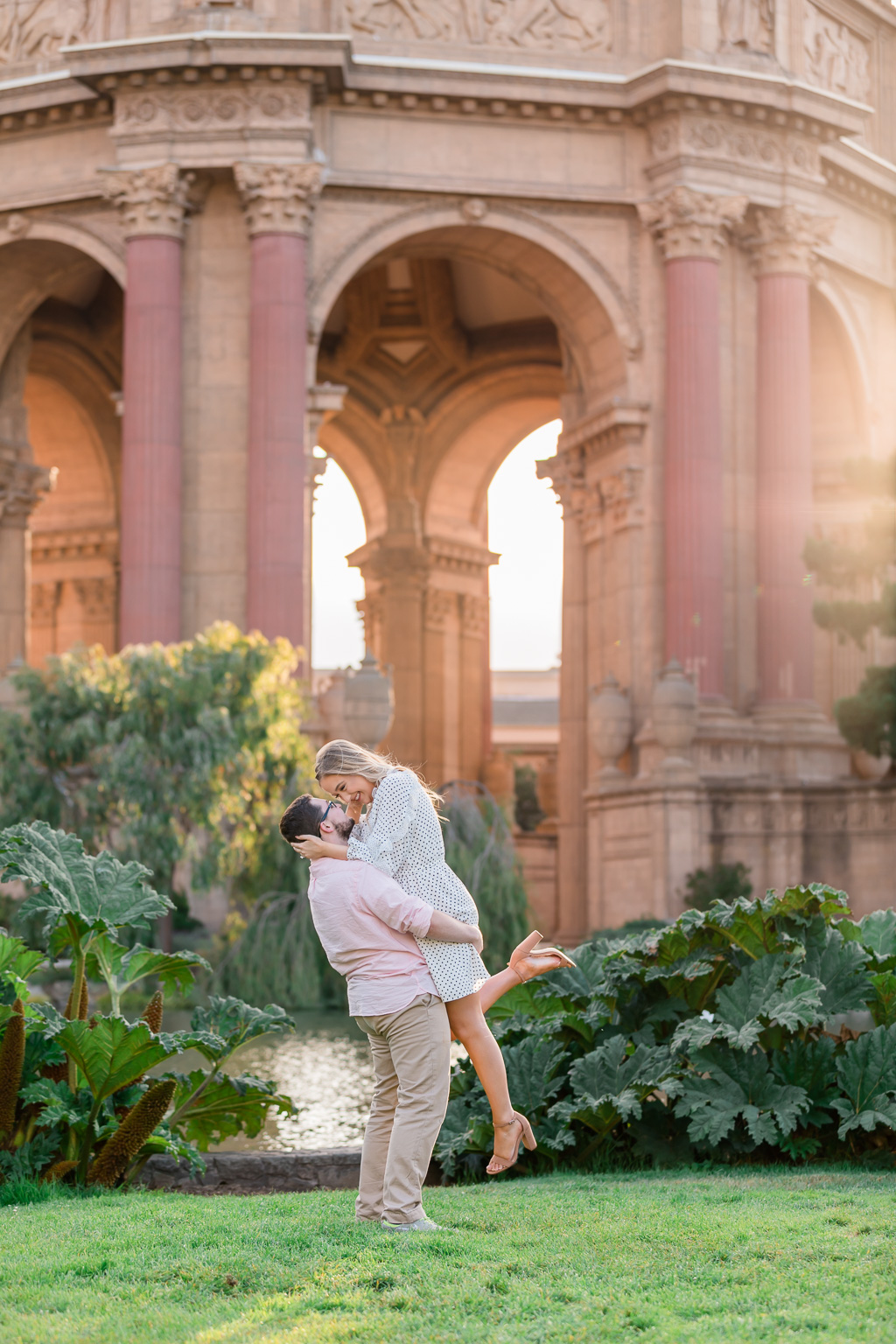 beautiful engagement photo at Palace of Fine Arts under the golden sunlight