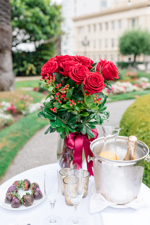 Fairmont SF set up the surprise table with roses, chocolates, and champagne for our newly engaged couple