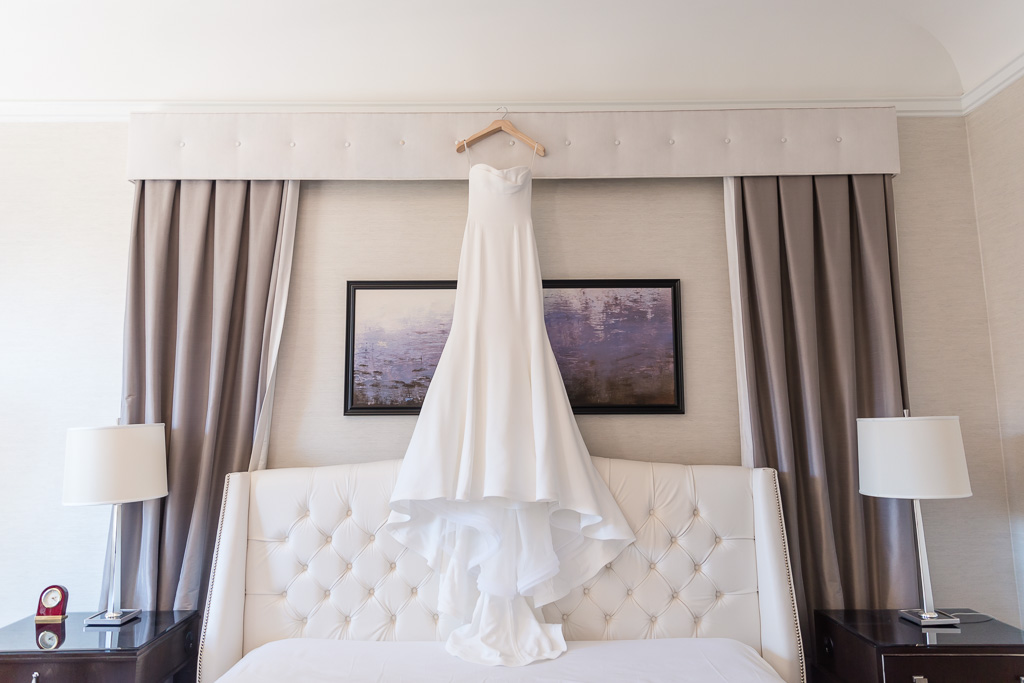 elegant wedding gown hanging in the SF Fairmont suite