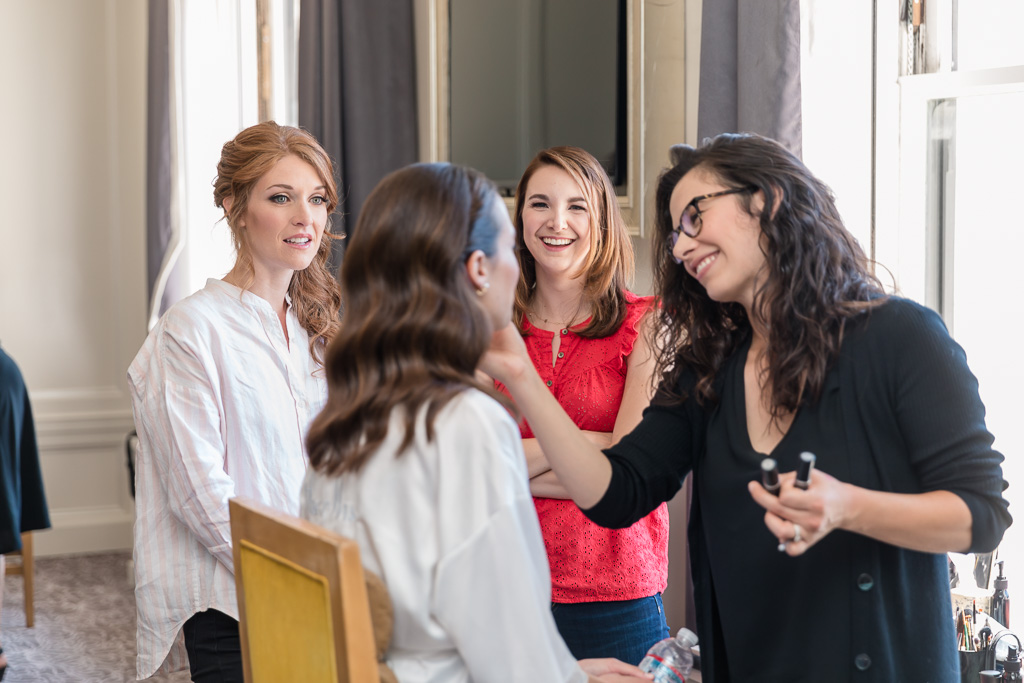 friends adoring the bride during getting ready