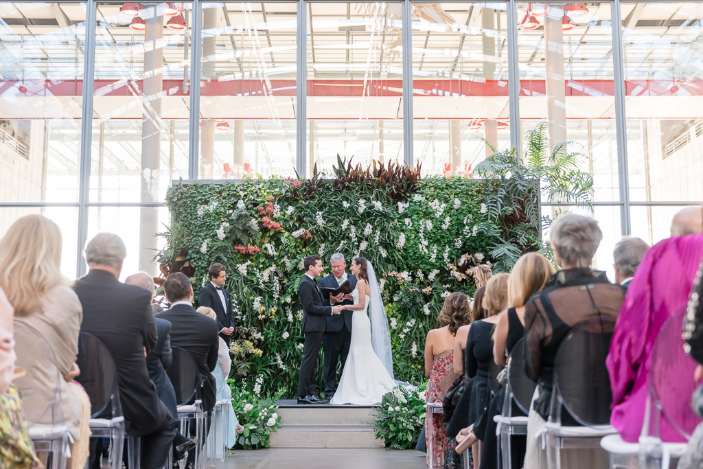 California Academy of Sciences wedding ceremony in front of the living wall