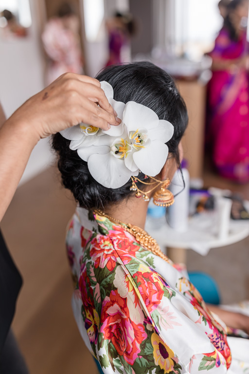 fresh white orchid as a part of the bridal hair piece