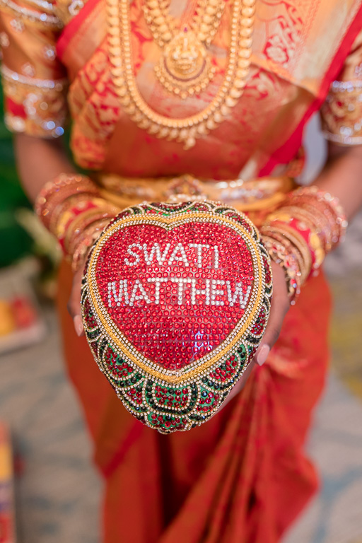 a coconut with bride and groom's name on it