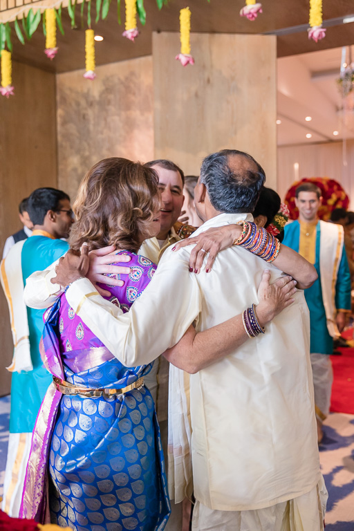 parents hugging each other after the ceremony