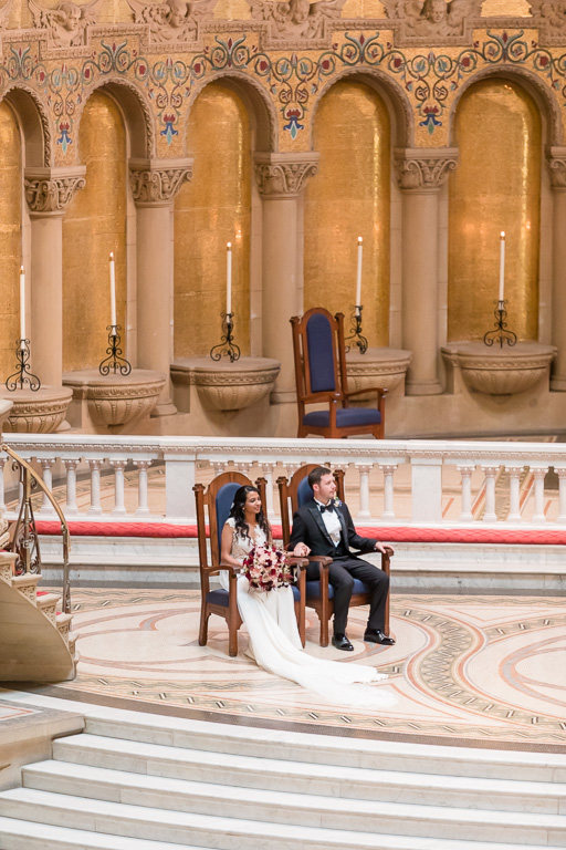 bride and groom in their chairs at ceremony