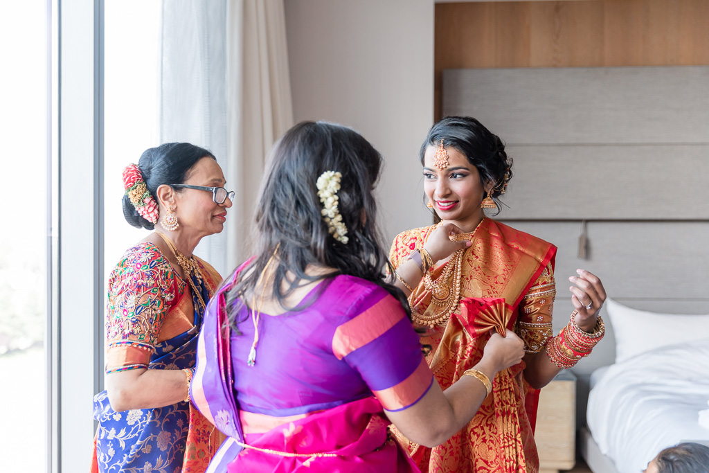 bride wearing a red sari for the hindu ceremony