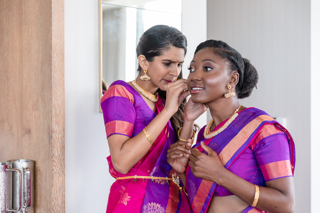 bridesmaid helping each other get ready