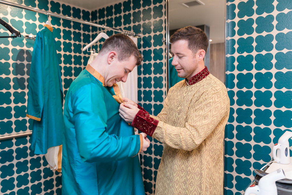 groom and brother getting ready together