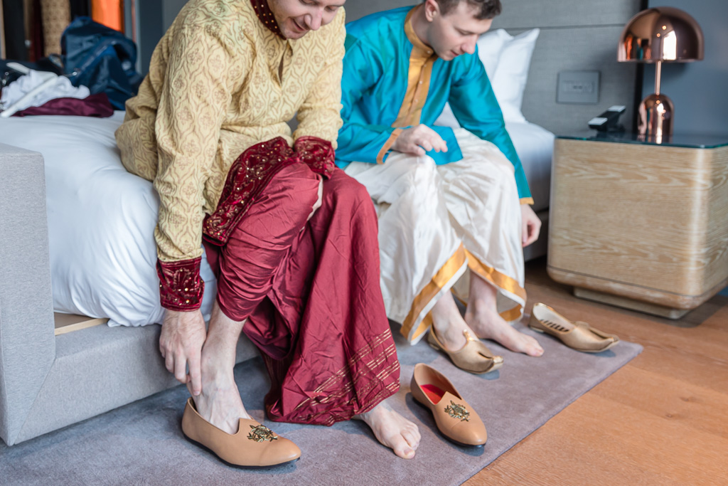 putting on the traditional shoes