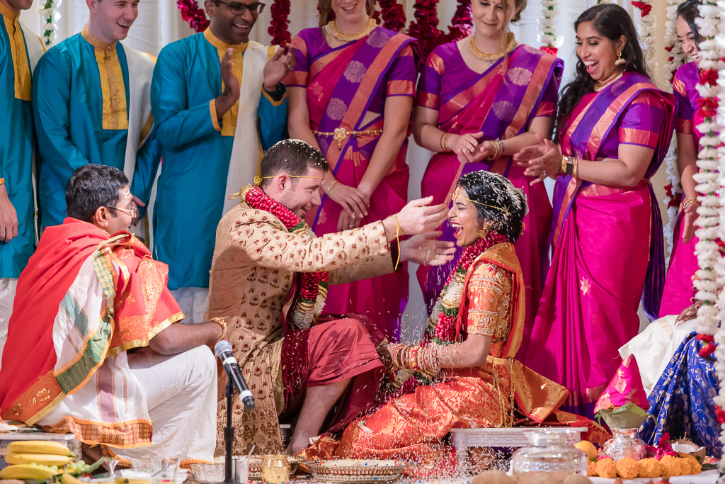 blessing with rice at the wedding ceremony