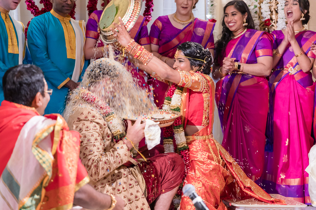 hilarious rice pouring at the San Francisco Hindu wedding ceremony