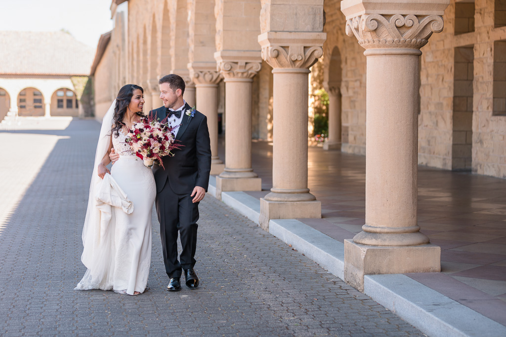 newlyweds walking in the Stanford main quad