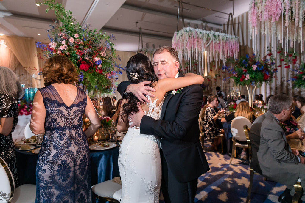 bride hugging her father-in-law