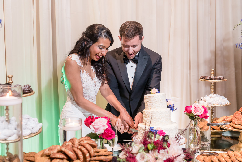 couple cutting their cake together