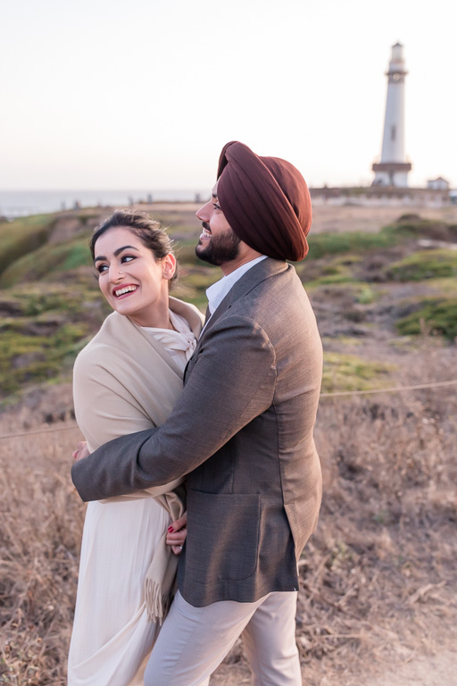 cute couple portrait in front of the lighthouse