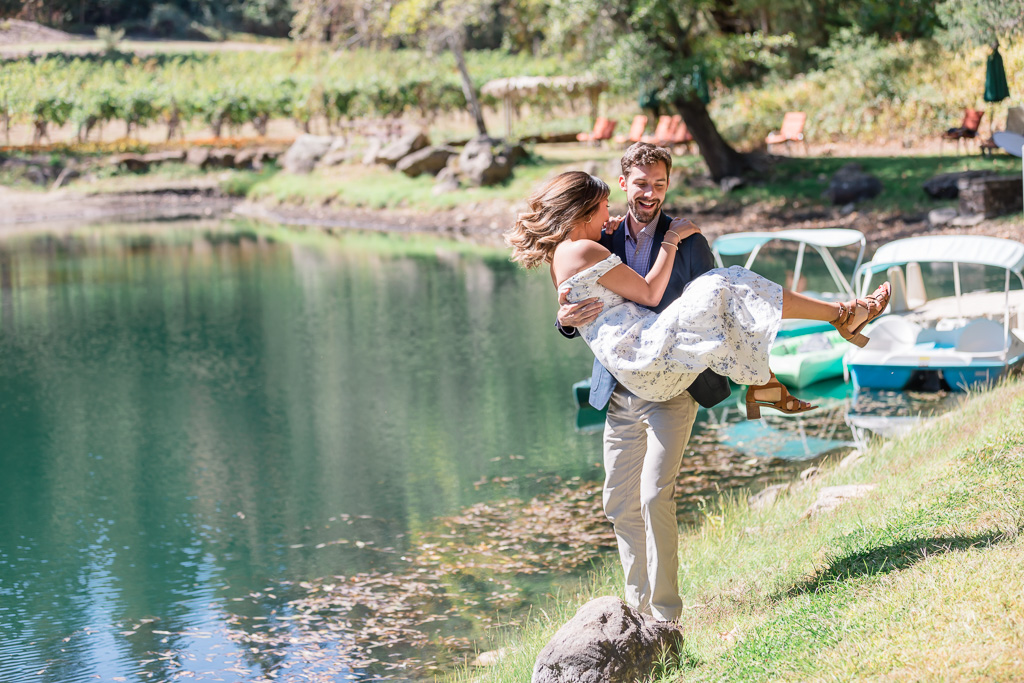 playful Napa engagement photo by the lake