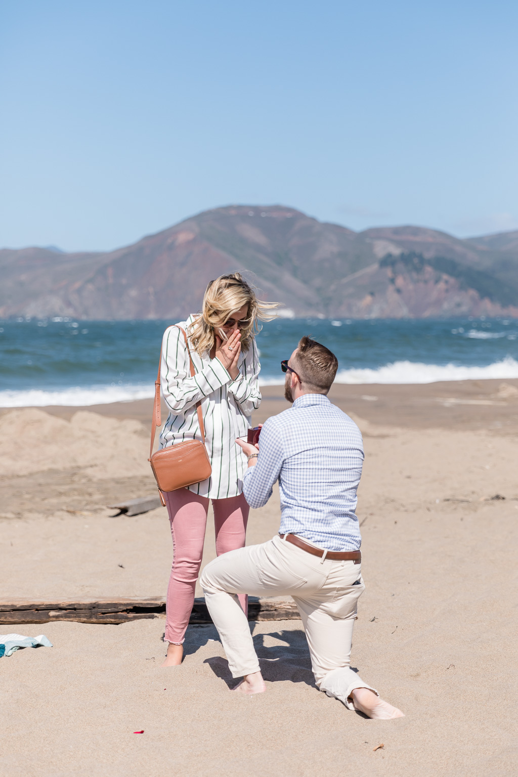 Baker Beach surprise engagement on a sunny day