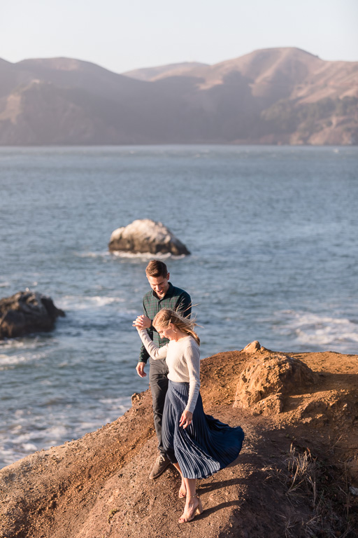 romantic San Francisco engagement photo by the cliff and ocean