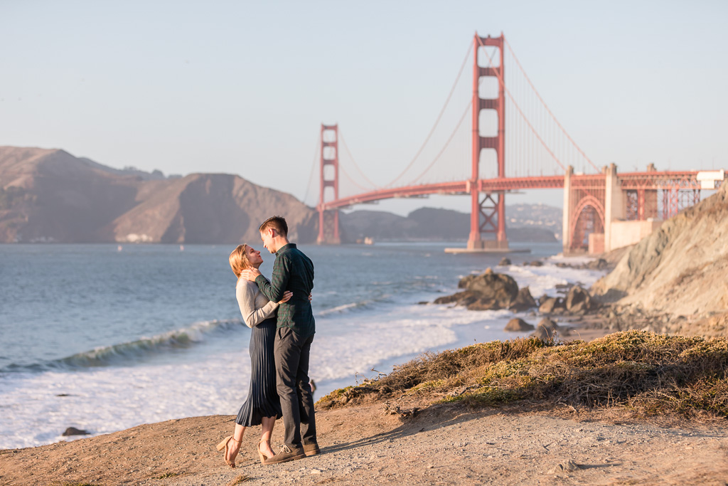 kissing in front of the old golden gate bridge
