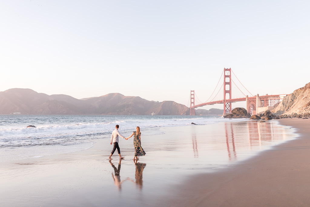 save the date engagement portrait on the sand beach with golden gate bridge