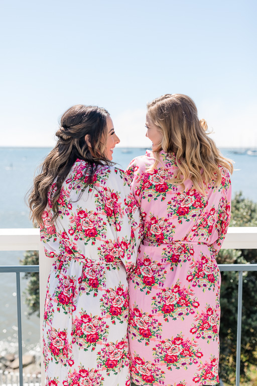 bride chilling with her bridesmaid in their floral robe