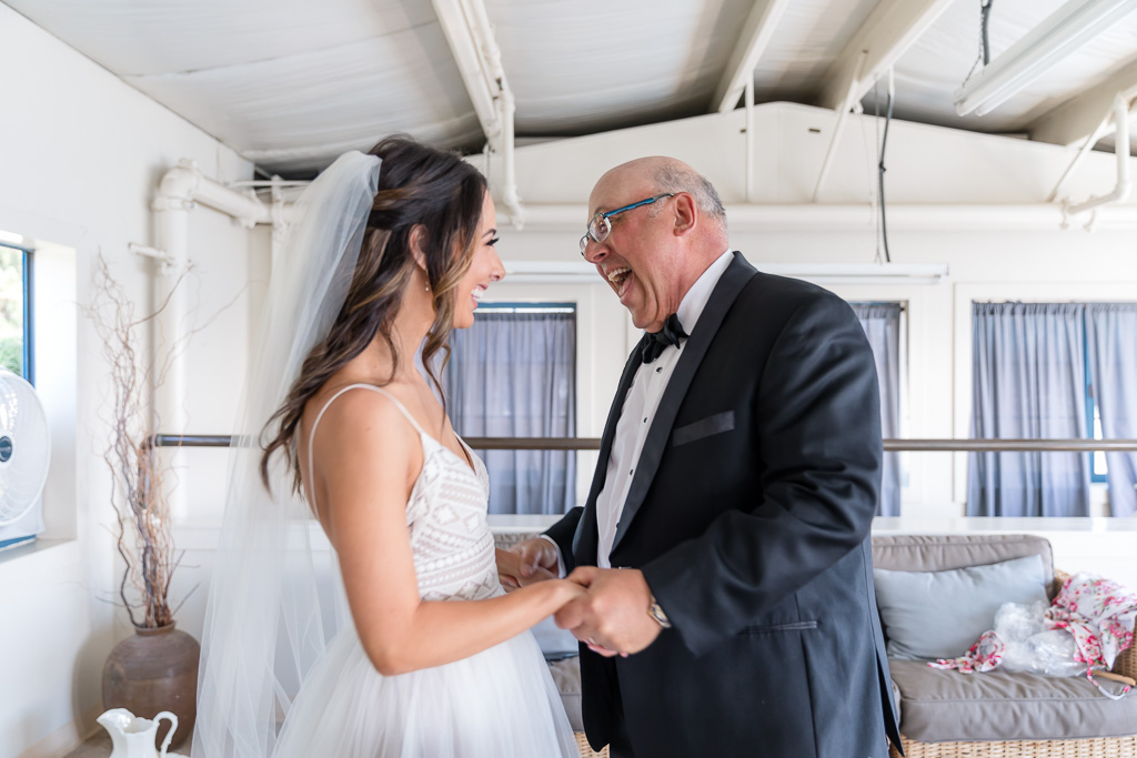 bride having a first look with her dad