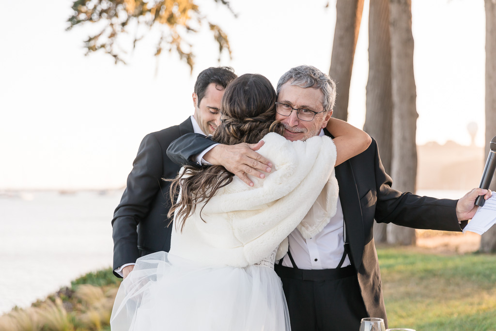 hugging father at reception toasting
