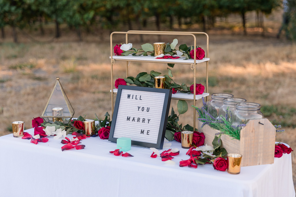 a sweet proposal table set up by the groom himself