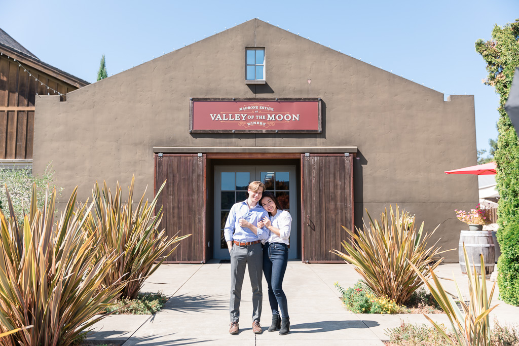 a picture of the couple in front of their favorite Sonoma winery