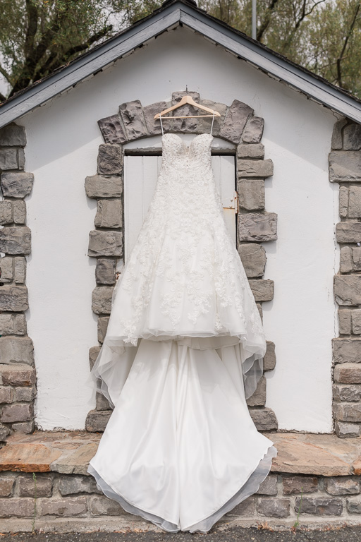 wedding gown hanging outdoors on a cute house