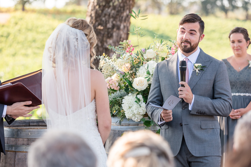 groom reads his vows at the ceremony