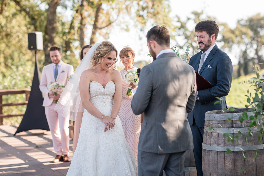 bride giggles at groom's sweet and funny vows