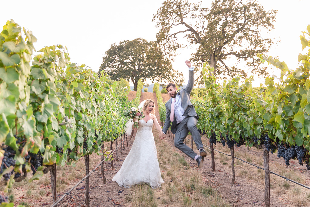 California winery golden hour playful wedding photo