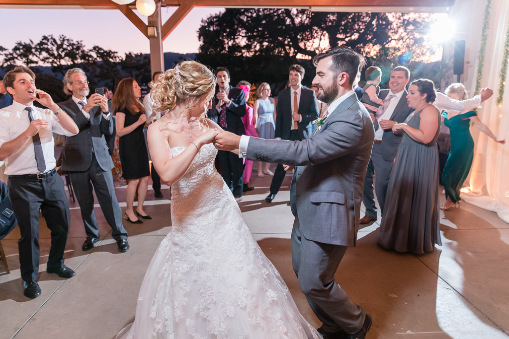 bride and groom dancing together at their reception dance party
