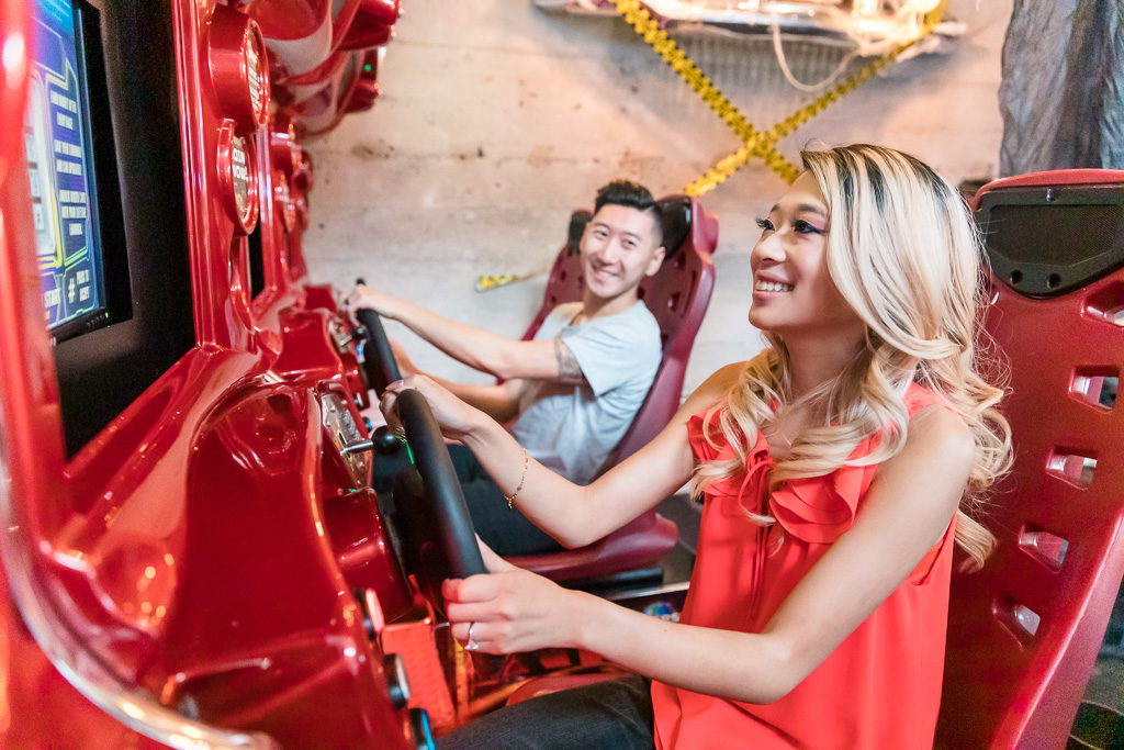 fun and colorful engagement photo at an arcade