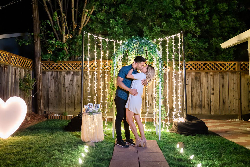 romantic and intimate San Francisco surprise engagement proposal with twinkle lights at night